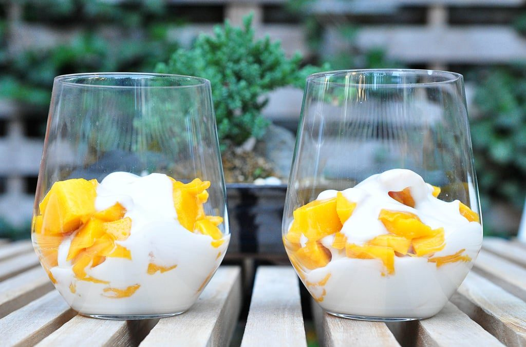 2 cups piled with chopped mango and coconut cream
