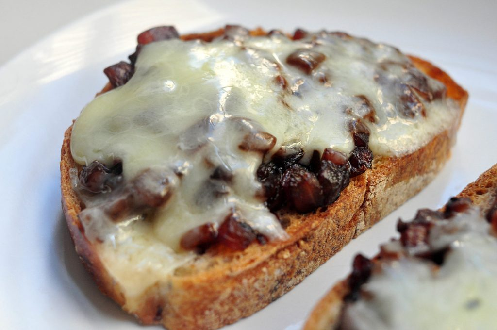 toast with caramelized onion and cheddar melted on top