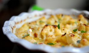 cauliflower baked in a cheese sauce served in a pie dish