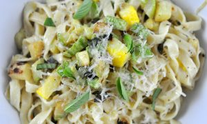 fettucine tossed with zucchini in a rich cream sauce