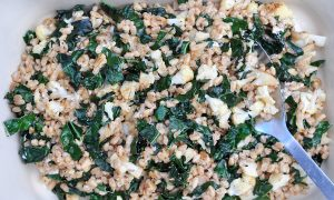 a large pan of farro, cauliflower and kale salad