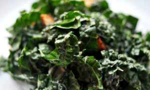 plate of kale caesar salad with croutons
