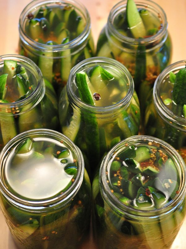 pickles with brine poured over them before lids go on.