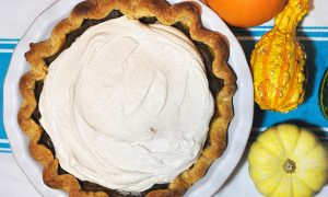 Pumpkin pie with a side of decorative gourds