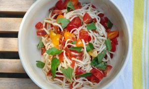 noodles tossed with tomato, basil and salami