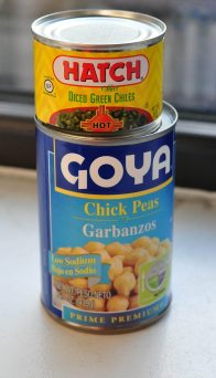 can of chickpeas and can of green chiles on top