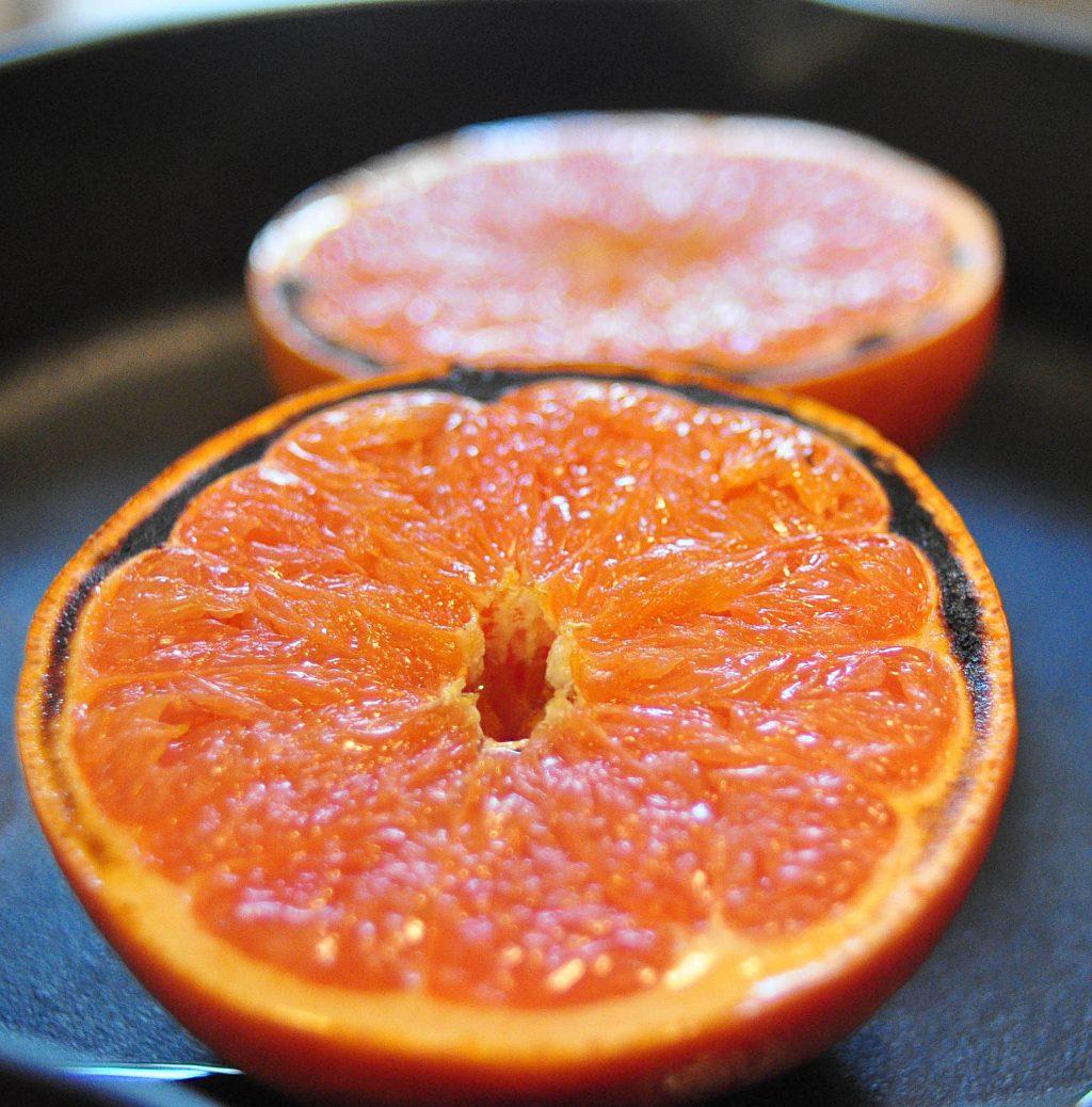 close up of half a grapefruit with slightly blackened edges