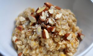 baklava oatmeal in a bowl, topped with chopped almonds